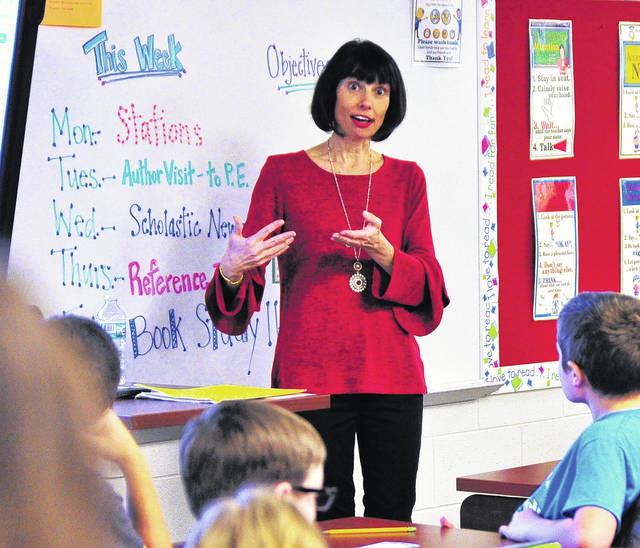 Mike Ullery | Daily Call New York Times Best-Selling author Margaret Peterson Haddix of Washington Court House speaks to students at Piqua Central Intermediate School on Tuesday.