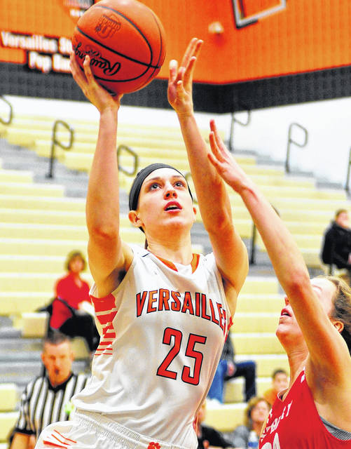 Mike Ullery | Daily Call Versailles' Lindsey Winner puts up a shot Thursday night.