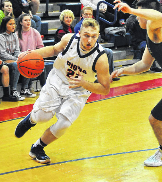 Mike Ullery | Daily Call Piqua senior Holden Yount drives to the hoop against Greenville on Tuesday.