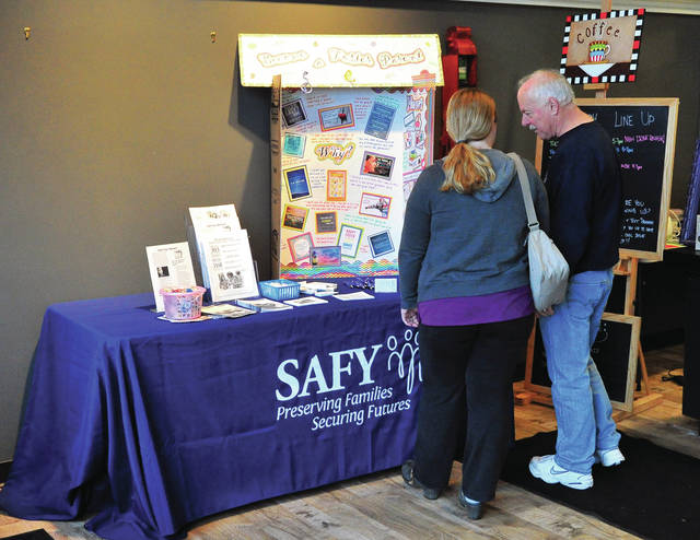 Mike Ullery | Daily Call A couple checks out foster care information from SAFY at Turntable Cafe on Wednesday.