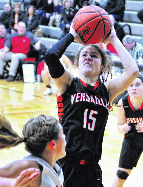 Mike Ullery | Daily Call Versailles' Hailey McEldowney scores against Dixie Saturday at Covington in D-III sectional action.