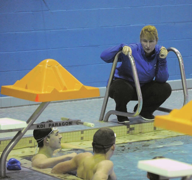 Josh Brown | AIM Media Midwest Miami East swimming coach Carol Bollinger talks to her Vikings during a practice at the Miami County YMCA in Piqua earlier this week.