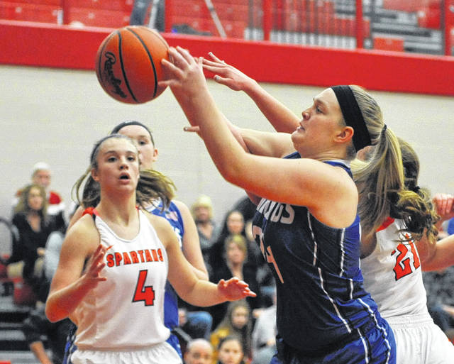 Josh Brown/Aim Media Photo Miami East's Mikayla Schaffner reaches for the ball against Waynesville Wednesday night.