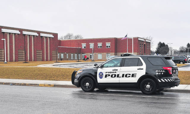 Mike Ullery | Dailuy Call A Piqua police cruiser parks near Washington Primary School on Thursday following vague threats made against a number of area schools overnight.