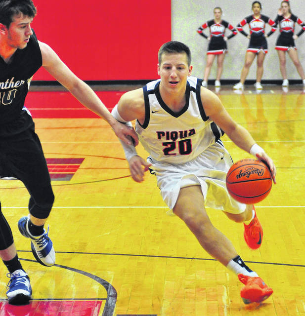 Mike Ullery | Daily Call Piqua's Mick Karn drives to the hoop against Springboro's Garrett Powell Friday night.