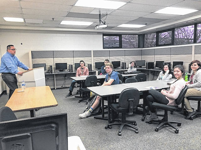 Group Sports Editor David Fong, left, shares his story about how chose a career in journalism with students at the Troy Area Chamber of Commerce's annual Career Day on Friday.