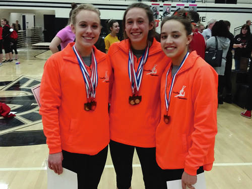 Photo Provided Versailles gymnasts Madison Ahrens, Jadyn Barga and Ellie Barga advanced to the state meet.