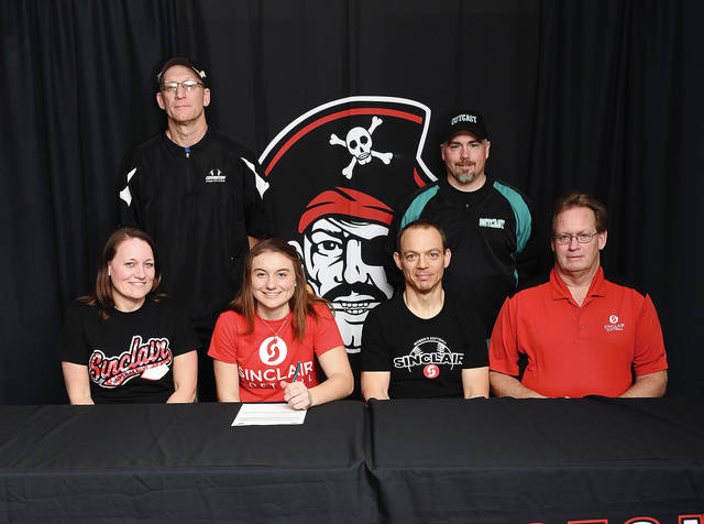 Ben Robinson/GoBuccs.com Covington High School senior Emma Dammeyer recently signed her letter of intent to play softball for Sinclair Community College. In front (left to right) are her mom Tammy, Dammeyer, her father Scott and Sinclair softball coach Steve Beacher. In back are former Covington softball coach Dean Denlinger and Covington softball coach Phil Smith.
