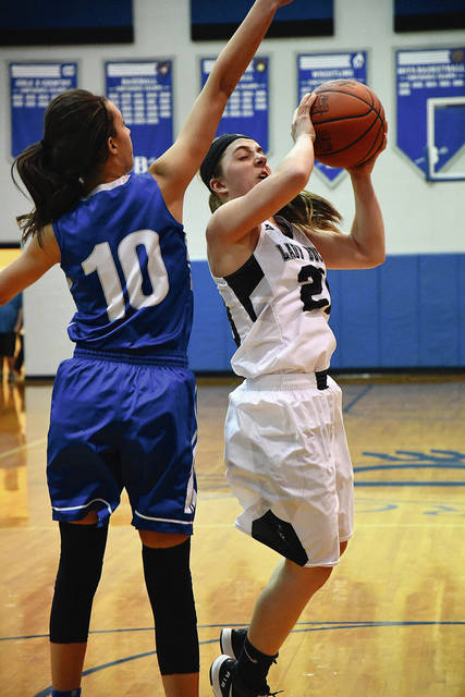 Ben Robinson/GoBuccs.com Covington's Morgan Kimmel puts up a shot against Franklin Monroe's Corina Conley Tuesday night.