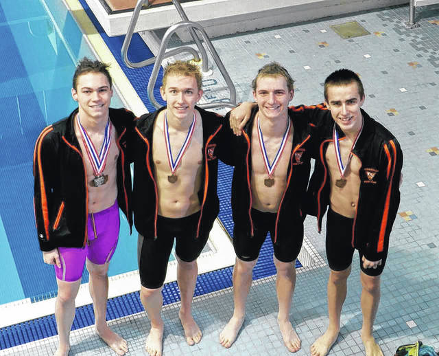Photo Provided The Versailles 2oo free relay team of Clint Morgan, Ryan Subler, Jack Detrick and Cole Condon qualified for the Division II state meet, while Condon also qualified in the 50 freestyle.