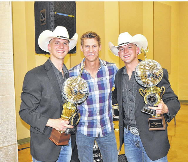 Provided photo Twin brothers Jared and Justin Younce (joined by country singer Clark Manson, center) will return to defend their Most Entertaining trophy won in last year's Dancing with the Piqua Stars. This year's event will take place April 21.