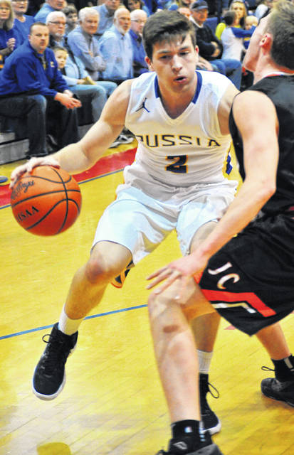 Russia's Jordan York drives against Jackson Center Friday night.