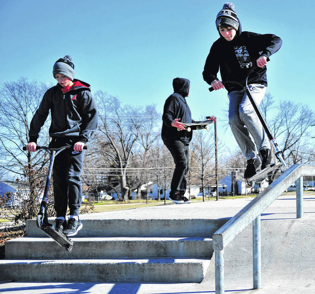 Mike Ullery | Daily Call Brock Smith and Laine Moses, 13, of Piqua enjoy the Piqua Skate Park on Saturday as bright sunshine urged residents outdoors to play.