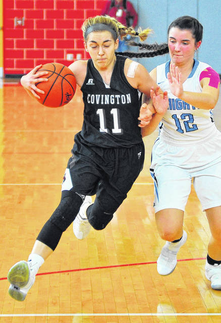 Covington's Samantha Whiteman drives to the basket against Legacy Christian's Olivia Combs Saturday at Troy High School.