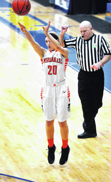 Versailles' Danielle Kunk hits one of her five 3-point field goals Wednesday night against Williamsburg.