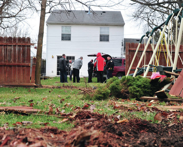Mike Ullery | AIM Media Midwest Tipp City and Troy police officers begin working the scene of a crash that occurred following a pursuit up I-75 on Wednesday that ended in the back yard of a West Market Street home.
