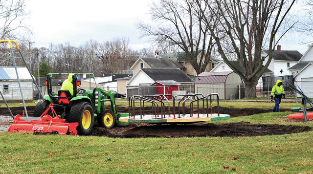 Mike Ullery | Daily Call Piqua Parks Department workers Jon Cox and Tyler Thompson work at Armory Park on Wednesday removing old playground equipment to bring the park up to current code.