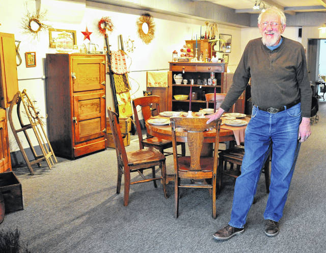 Mike Ullery | Daily Call Steve Greggerson, who, along with his wife Mindy, operates The Mercantile store on North Main Street in Piqua, shows some of the many items that can be found in the store.