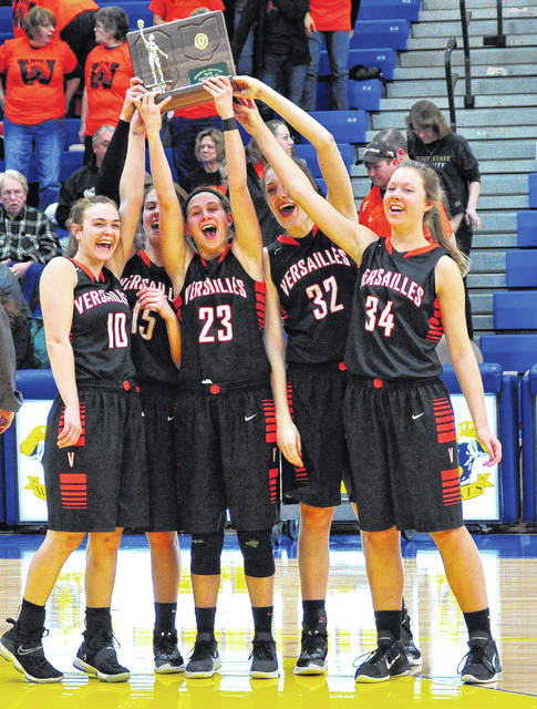Mike Ullery/Call Photo Versailles seniors Kami McEldowney (10), Hailey McEldowney (15), Ellen Peters (23), Danielle Winner (32) and Mallory Marshal (34) celebrate the D-III regional title with their fans last Saturday.