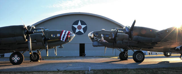 Mike Ullery | AIM Media Midwest Iconic B-17 Flying Fortress <em>Memphis Belle</em>, left, poses for photos along with <em>Shoo Shoo Baby</em> at the National Museum of the United States Air Force on March 14, 2018. Following years of restoration, <em>Memphis Belle</em> is being moved inside the World War II Gallery where she will be officially unveiled during ceremonies at the museum on May 17. <em>Memphis Belle</em> is widely known for being the first B-17 to complete 25 missions over Europe in World War II before returning to the U.S. where she and her crew were featured on a War Bonds Tour. One of those stops was in Dayton. She has also been featured in two Hollywood films. <em>Shoo Shoo Baby</em>, which has been on display inside the museum will be returned to her owners at the Smithsonian Air & Space Museum.