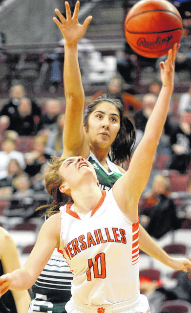 Versailles' Kami McEldowney lays up a shot against Elyria Catholic's Kaylie Griffin Thursday at the Schottenstein Center.