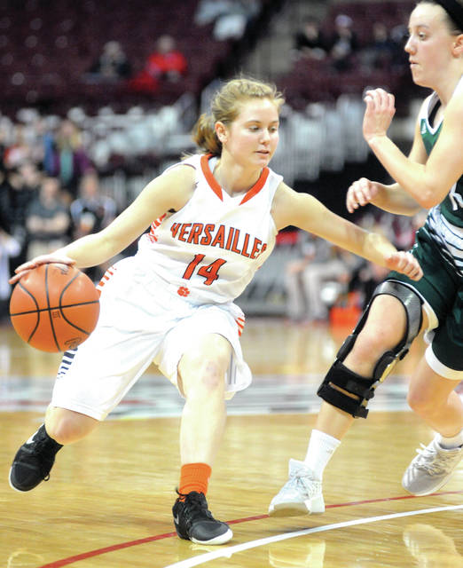 Versailles' Caitlin McEldowney brings the ball down the floor against Elyria Catholic Thursday at the Schottenstein Center.