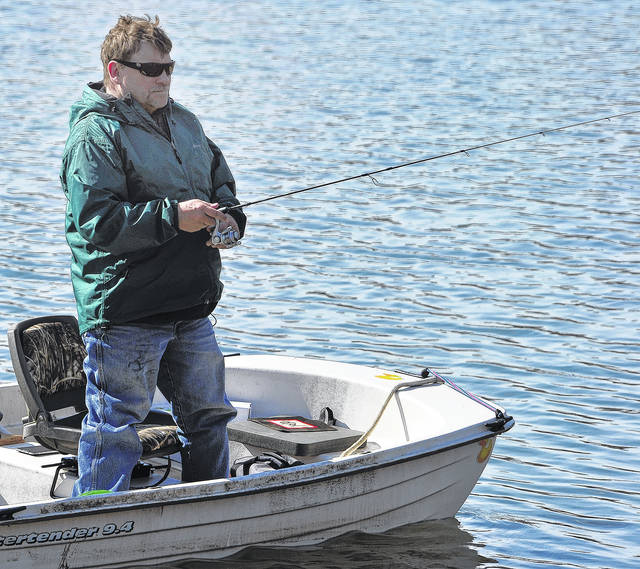 "Mike Ullery | Daily Call Piqua resident Chris Wood gets in some early season fishing on Echo Lake from his boat christened ""Bass Tub"" on Monday afternoon."
