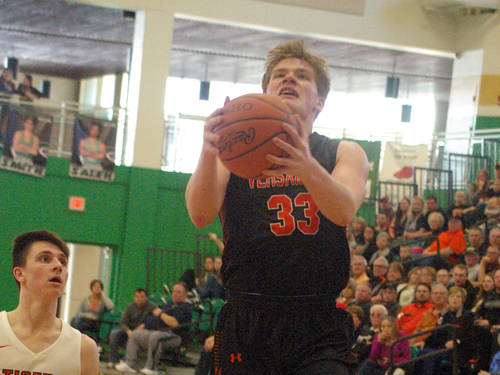 Versailles' AJ Ahrens drives to the basket during an Ohio High School Athletic Association sectional championship boys basketball game against West Liberty-Salem on Saturday at Northmont.