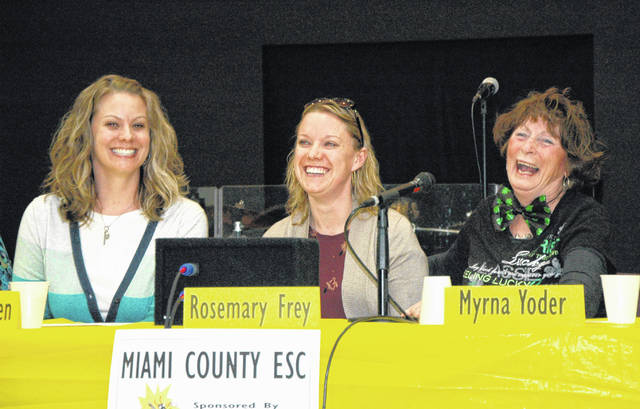 Cody Willoughby | AIM Media Midwest Left to right, Bethany Whidden, Rosemary Frey, and Myrna Yoder from the Miami County Educational Service Center revel in their victory at the 24th annual Bee for Literacy on Thursday.
