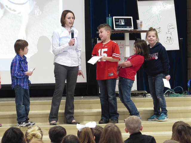 Sam Wildow | Daily Call Author Kristen Otte, center, answers a question from student Remi Donna, center right, as other students line up to ask questions at Washington Primary School on Friday as part of the school's Right to Read Week.