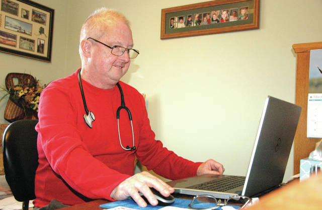 Cody Willoughby | Troy Daily News Dr. Robert C. Landes, MD, reflects upon a career in family medicine at his Miami County home on Saturday. His retirement will be celebrated with an open house event scheduled for Sunday, March 18.
