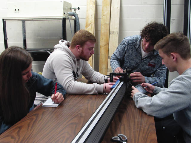 Sam Wildow | Daily Call From left to right, Piqua High School juniors Maddison McMaken, Mathew Langston, Cade LYman, and Brennan Toopes start a laboratory experiment using Vernier lab equipment.