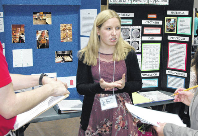 Cody Willoughby   AIM Media Midwest Tippecanoe High School junior Victoria Jacobs explains her project to judges during the Upper Miami Valley District 1 Science Day, held at Edison State Community College on Saturday.