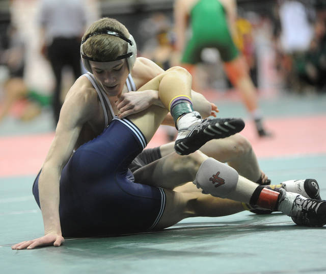 Ben Robinson/GoBuccs.com Covington's Cael Vanderhorst controls Antonio Lecky of Millbury Lake in a 113-pound consolation match at the D-III state wrestling tournament.