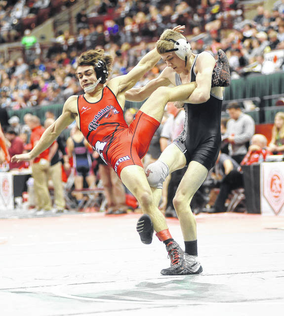 Covington's Cael Vanderhorst goes for a single leg on Austin Guthrie of Coshocton in the 113-pound seventh-place match at the Division III state wrestling tournament Saturday.