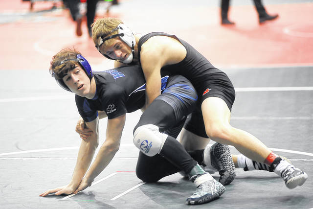 Ben Robinson/GoBuccs.com Versailles' Preston Platfoot controls Cael Rowland of West Salem Northwestern in a 132-pound seventh-place match at the Division III state wrestling tournament Saturday.