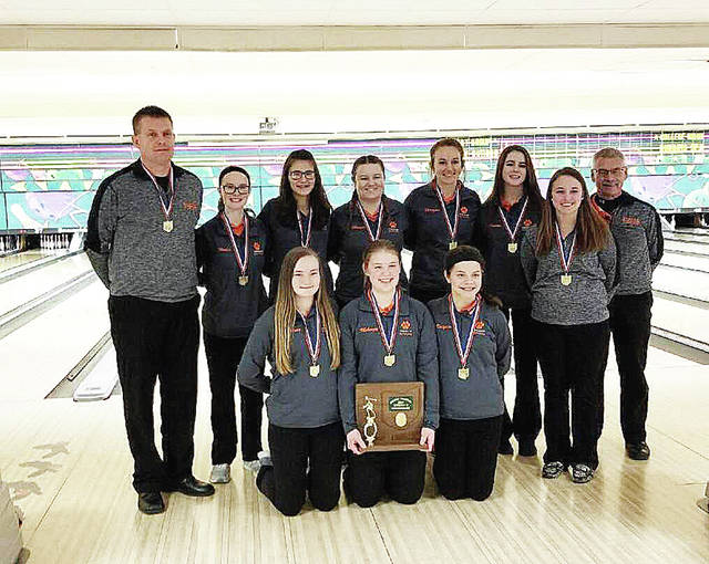 Photo Provided Versailles girls bowling team is shown after winning the program's first district championship. They bowl in the state tournament Saturday.