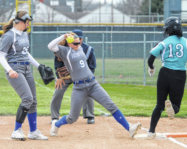 Mike Ullery | Daily Call Cuyahoga Community College's Courtney Cadle beats Edison State's Tori Smith to the bag by a step in the first inning at Covington High School Friday.