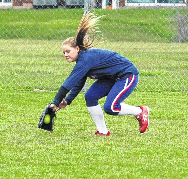 Piqua's leftfielder Paige Hinkle snags a fly ball on the run against Tippecanoe Monday.