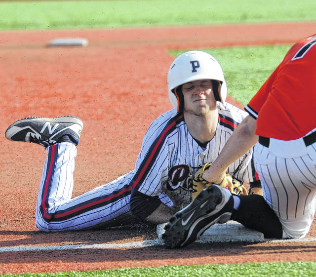 Piqua's Cory Cotrell beats the tag at third base against Beavercreek on a steal Thursday at Wright State.