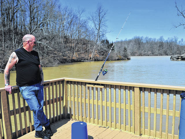 Mike Ullery | Daily Call John Sloan of Sidney watches his line as he gets in some fishing time on Swift Run Lake during our first over-70 degree day of the year on Thursday. While there was plenty of sunshine, windy conditions produced whitecaps across the lake.