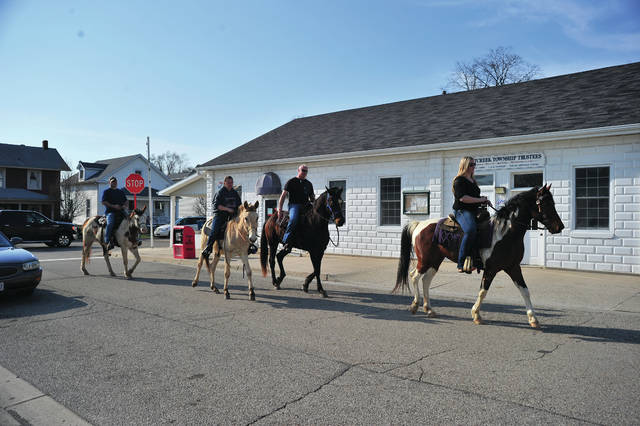 Mike Ullery | AIM Media Midwest Scott Gates and his posse, including Jim Short, Christine and Amy Buchert, sit tall in the saddle as they enjoy a spring afternoon ride through Casstown on Friday evening.