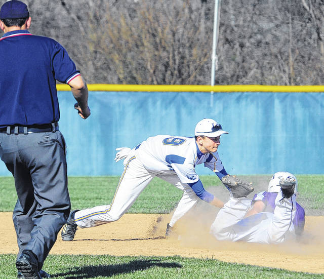 Lehman Catholic shortstop Alex Keller puts the tag as Fort Recovery;s Riley Post steals second.