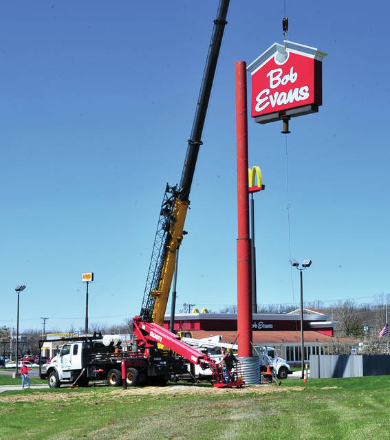 Mike Ullery | Daily Call Work crews set a new sign at Bob Evans at the Miami Valley Centre Mall in Piqua on Friday afternoon. Sign Dynamics out of Dayton replaced the sign which was badly damaged in a wind storm last year.