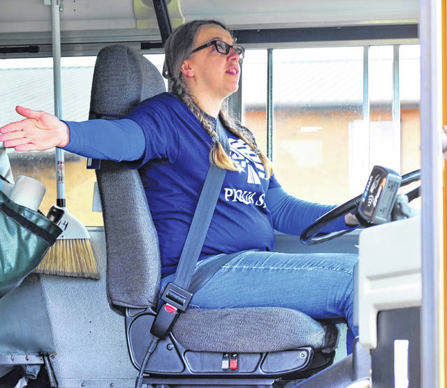 Mike Ullery | Daily Call Piqua bus driver Donnelle Walling signals to during Saturday's bus rodeo at Piqua Junior High School. Drivers from districts around the area competed in tests of skills behind the wheel.
