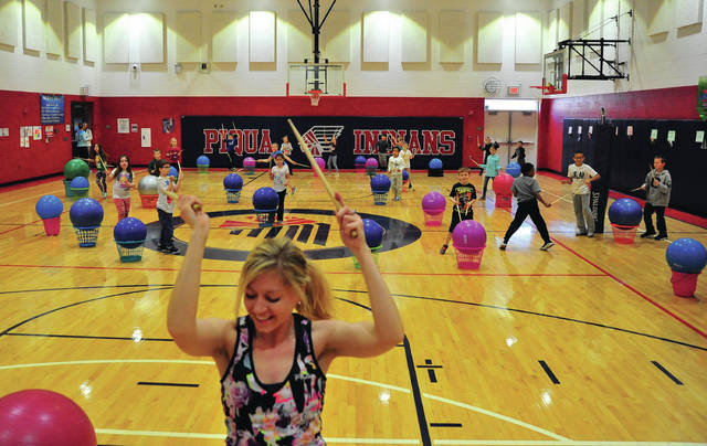 Mike Ullery | Daily Call Brooke Spradlin of Piqua leads Washington Primary School second graders in a cardio drumming class on Monday morning as Healthy Kids Week kicks off in Piqua's elementary schools.