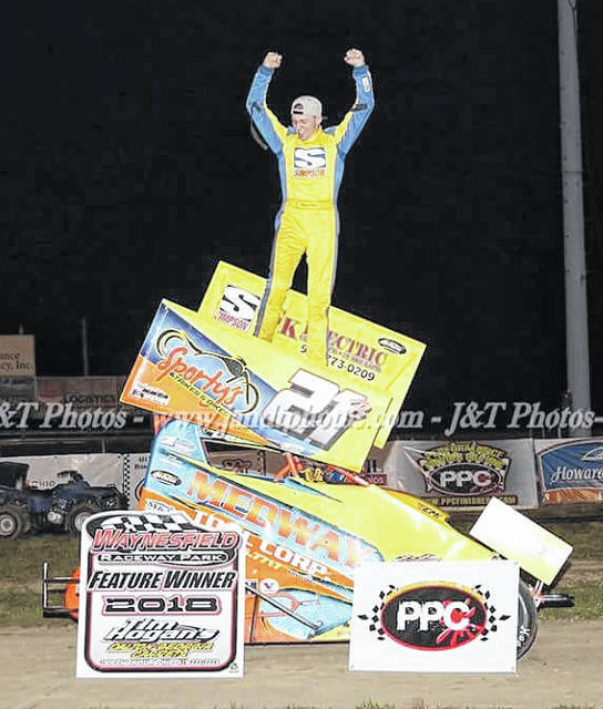 Photo Provided by J&T Photos Ryan Barr celebrates after getting his first feature win at Waynesfield Motorsports Park Saturday.