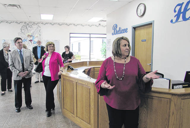 Sam Wildow | Daily Call Executive Director Carla M. Bertke, far right, of the Hahn Hufford Center of Hope, introduces the new Paul H. Sherry Adult Day Services Room at the facility during an open house held Thursday evening.