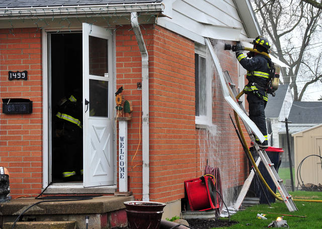 Piqua firefighters battle a fire in a duplex on Plum Street on Saturday morning. Piqua and Covington fire departments are on the scene.