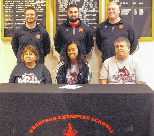 Kyle Shaner/Aim Media Photo Bradford High School senior Maia Stump signed a letter of intent to continue her track career at Indiana UniversityEast Monday. In front are Stump and her parents Angie and Don Stump. In back are Bradford coaches Rob Grillot, Ron Hoelscher and Brian Schweiterman. Mom Angie Stump, Dad Don Stump